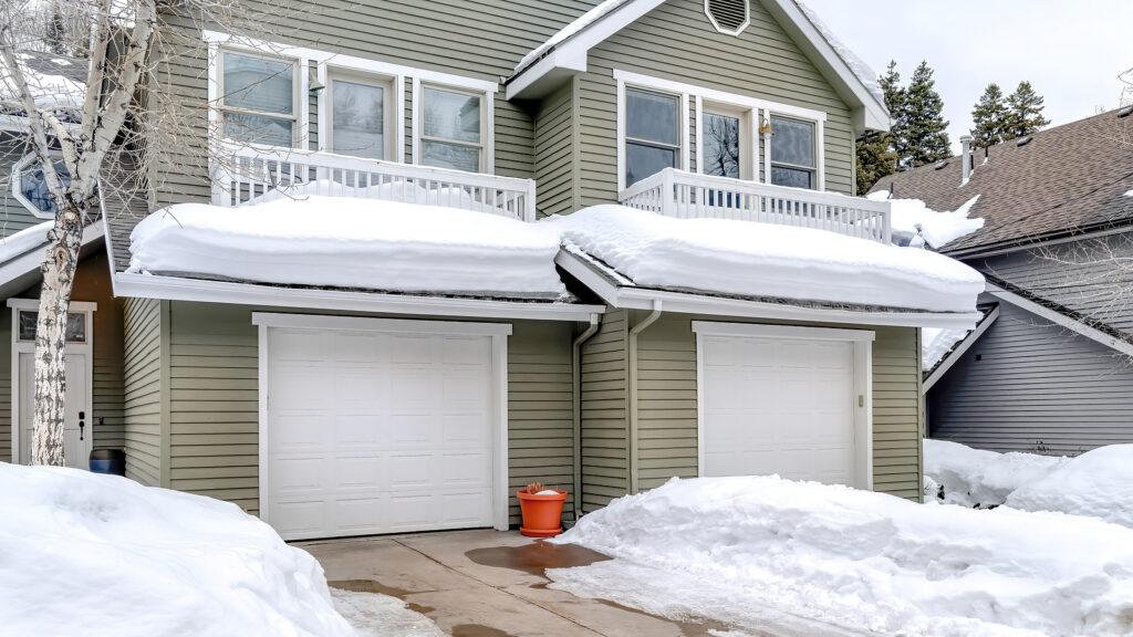 Garage door in snow - best weather stripping for old doors
